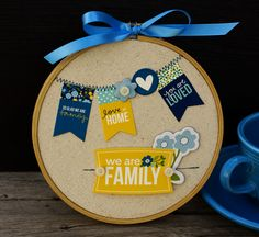 LOVE this little embroidery hoop embellished with scrapbooking supplies:)