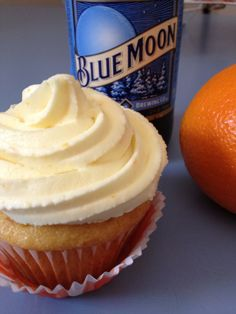 Blue Moon Cupcakes with Orange Buttercream Frosting.I thought cupcakes were awesome before I saw this! Cupcake Recipes, Cupcake Cakes, Dessert Recipes, Beer Cupcakes, Mini Cakes, Just Desserts, Delicious Desserts, Yummy Food, Fancy Desserts