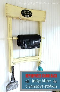 Kitty litter changing station made from a repurposed chair back.  Organize your kitty litter box area with this DIY command center using an old chair back.