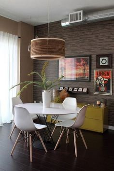 Retro modern, nice lamp | via http://www.apartmenttherapy.com love the round table and chairs. love white. #Modernkitchentable