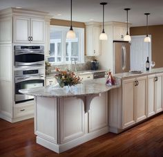 Love the cabinets on one side for extra storage, maybe with a seating area for 2 bar stools on one end