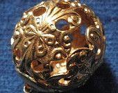 """Antique metal button, Art Nouveau """"cricket cage"""", filigree & ball shaped - a floral design.  1900-1910."""