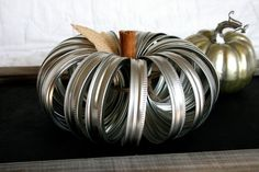 How clever! It's a pumpkin made from mason jar lids, by hawthornehill on Etsy.