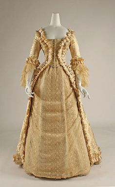 Wedding dress Date: early 1880s Culture: American Medium: silk Dimensions: Length at CB (a): 64 1/2 in. (163.8 cm) Length at CB (b): 41 in. (104.1 cm) Credit Line: Gift of Richard Martin, 1998