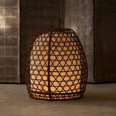 Woven Orb Lantern by Alexander Lamont based on Balinese cock-fighting baskets.