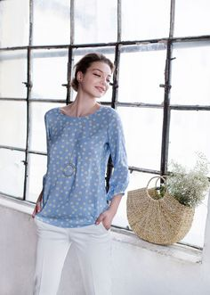 Cut from soft, breathable fabric, this blouse displays a charming neckline with self-tie ribbon in the back and slightly puffy sleeves gathered by thin cuffs. The design is adorned by its delicate floral print. Blue Blouse, Cuffs, Floral Prints, Delicate, Ribbon, Neckline, Tie, Fabric, Tela