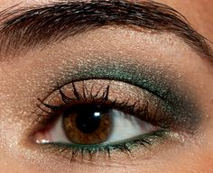 NARS Smudgeproof Eyeshadow Base (primer), Le Metier de Beaute Blonde Amber Eyeshadow (wheat gold), Le Metier de Beaute Bronze Topaz Eyeshadow (bronze), Le Metier de Beaute Black Emerald Eyeshadow (blackened emerald green), Make Up For Ever #20L Aqua Eyes Liner (forest green),