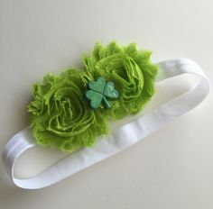St. Patricks Day , what better way to avoid getting pinched by wearing our new green Lucky  headband!!   Shabby Flowers.  Headband size:  Newborn 13 inches 3-6 months 14 inches 6-12 months 15 inches 12-24 months 16 inches 2 years & Up 17 inches  IF NO SIZE IS SPECIFIED WE WILL SEND 15 INCHES  Colors can be customized, please contact me if you have any questions.  **Disclaimer** All items sold in my shop may contain small parts. Please do not leave small children and babies unattended whil...