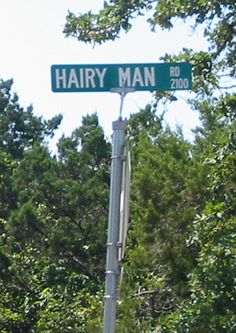 The Legend of Hairy Man Road Yes, there is a road named Hairy Man Road. Located in Round Rock, the legend goes that a young boy in the 1800's became separated from a settlers' caravan during a dark and stormy night, while the group was trying to escape the rising waters of a nearby creek.  He managed to