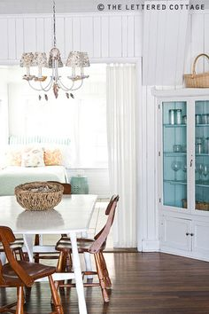 Love the painted interior of this cabinet!