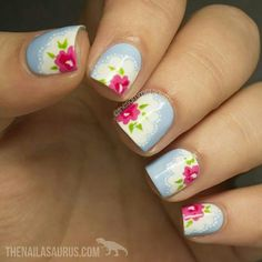 Pale blue nails, intricate pink flower design with lace border