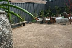 Backyard sandpit & built in rustic seat, now just to add a fire pit.Garden design by RPGD  www.rpgardendesign.com.au