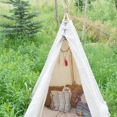 Looking for an interesting outdoor activity to do at home with your kids this summer? This DIY backyard teepee from @FawnOverBaby is a great way to spend time with the family and add a unique, crafty touch to your outdoor living area! #DIY #DIYcraft #tipi #teepee #homemade #backyard #camping #kidcrafts #familytime #familyfun #unique #crafts