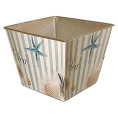 Set of six striped metal planters with seaside motifs.  Product: Set of 6 plantersConstruction Material: MetalColor: White and blieDimensions: 4.5 H x 5 W x 5 D