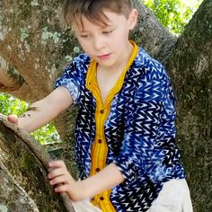 Boy's mandarin collar button up shirt in navy geometric print with contrasting yellow features. Baby boys to tween boy sizes. Shop boy's coastal styles > Online or visit us in Noosa! Coastal Style, Mandarin Collar, Tween, Baby Boys, Button Up Shirts, Kids Outfits, Navy, Yellow, Shop