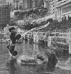 Paul Hawkins crashes into Monaco harbour during the 1965 Grand Prix