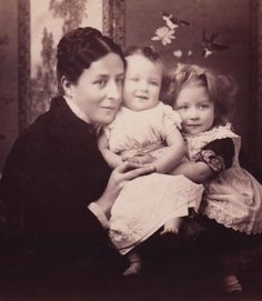 :::::::::::: Antique Photograph ::::::::::::  Charming portrait of a Mother and her smiling children.