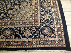 Persian rug w/ dark blue
