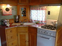 1953 Owasso Vintage Trailer Kitchen...look at those red counters...ahhh... love those