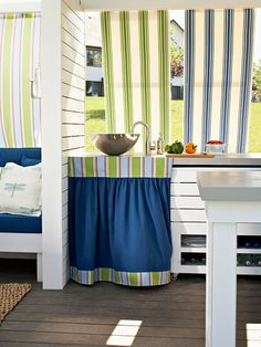 Put Outdoor Fabrics to Work to provide privacy on your porch, deck and outdoor living areas. BHG