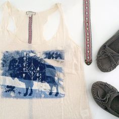 """Bohemian buffalo print beige tank NWT Buffalo print tank. Brand is Eyeshadow. Size large. Color is oatmeal. Measures 18.5"""" from underarm to underarm laying flat. 26"""" from shoulder to hem. 50% polyester, 36% cotton, 14% rayon. Open to reasonable offers! Eyeshadow Tops Tank Tops"""