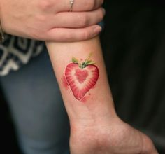 Strawberry wrist tattoo by Joice Wang
