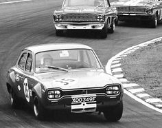 Alan Mann Racing Escort with Ford Falcons in hot pursuit...