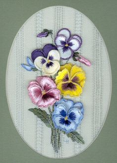 "Pansies and Lace - #2641  Stumpwork Pansies are arranged on a background of 25 count evenweave linen that has been embellished with two different hemstitching patterns.  The pansy petals are printed in color on fused silk, ready to add wire and embroidery.  This full kit includes printed linen, lining, printed and fused silk for the stumpwork pansies, wire, needles, Rajmahal art silk, and Edmar Brazilian threads for all the work.  Finished piece fits a 5"" x 7"" mat or frame.     $30.00"