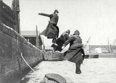 c.1930:  Policemen testing life-jackets, London