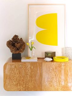 http://design-milk.com/11-rooms-sunshine-y-bright-spots/yellow-print-sideboard/