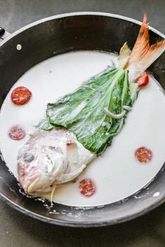 Sinanglay is a Filipino dish made up of green leafy vegetable wrapped fish cooked in coconut milk and chillies. Usually it is prepared with tilapia while the leaf used is a taro or a large pechay.