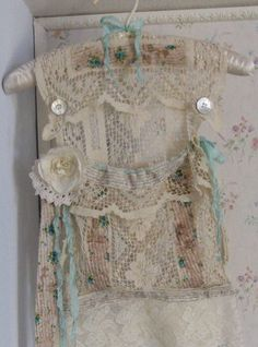 Shabby Chic Peg Bag using a padded coat hanger & venetian lace tablecloth scraps & buttons