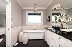 Here are 30 Gorgeous Black and White Bathroom Decorating Ideas. Beautiful bathroom design and decor ideas. Colorful bathroom design ideas that you want for y. White Bathroom Cabinets, White Bathroom Decor, Gray And White Bathroom, Bathroom Ideas, White Cabinets, Bathroom Designs, Master Bathroom, 1920s Bathroom, Bathroom Niche