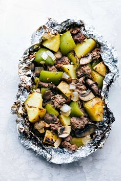 """Simple Tin Foil Pack """"Philly Cheesesteak"""" Dinners. Perfect for the campfire, grill, or the oven! Everyone that tries these goes crazy for them!"""