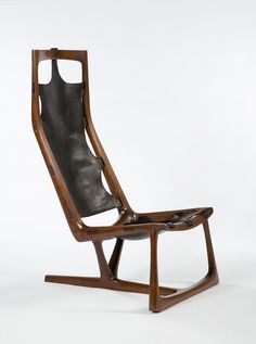 """Early """"Kangaroo"""" Chair, 1962. Walnut and leather. By Wendell Castle via Dwell"""