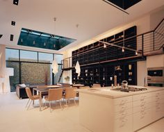 open concept kitchen, dining and living room with a wall of windows