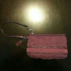 Wristlet Purple in color, says coach it was a gift not sure if it's authentic or not.. used a handle full of times.. Bags Clutches & Wristlets
