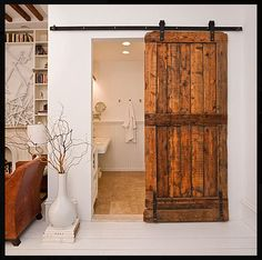 Hi Friends!Lately I've been running across a myriad of sliding barn door eye candy so I thought it would be fun to post about this lasting trend. Sliding Barn doors on rails have always been a favorite look of mine.