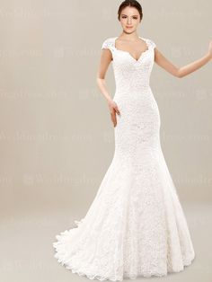 Unique Lace wedding dress is glamour and romantic. Highlighted with cap sleeves, this dress is fitted through the hip and then flares into a mermaid style. Back is zipper closure with covered buttons.