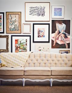 eclectic wall gallery over the couch?