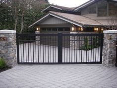 Picket Driveway Gates A picket Gate doesnt have to look like you are in a jail cell A few simple modifications and adding features turns a plain gate into a feature piece. Metal Driveway Gates, Modern Driveway, Iron Garden Gates, Driveway Entrance, Metal Gates, Automatic Driveway Gates, Electric Driveway Gates, Fence Gate Design, Steel Gate Design