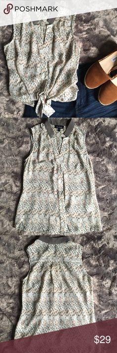 EUC Sleeveless Leopard Print Top EUC Bebe button up top w subtle leopard print.   Colors in it are seafoam blue, peach, taupe and gray.   Fabric is lightweight and is somewhat sheer.  Best layered w a nude bralette or cami.   Sz xxs and is tts.   Model is 32b/25 waist for reference. bebe Tops Blouses