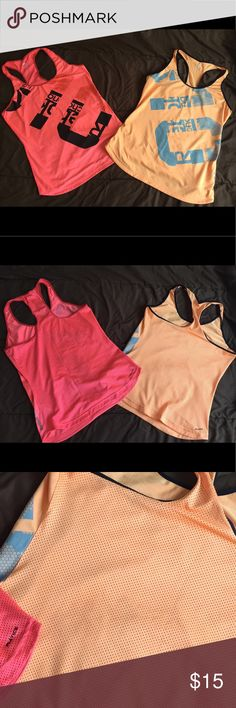 🌟2 Set Reebok Workout Tops Both a Size Medium, used in good condition. I've barely worn these, just cleaning out my closet. They're cute and stretchy, with mesh holes in the back for some air flow when working out! Reebok Tops Tank Tops