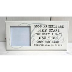 Bílý fotorám s nápisem Good Friends Are Like Stars, Container