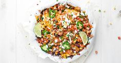 These Loaded Chicken Nachos have 12 layers and are full of tender veggies, flavorful chicken, beans, corn, and TONS of cheese. Quick, easy and delicious!