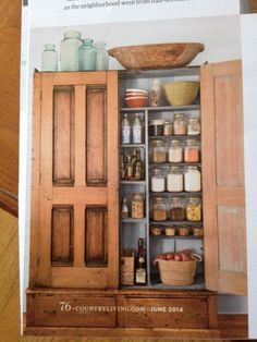 Armoire turned into kitchen pantry by adding extra shelves and magnetic door closures