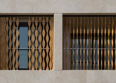 Wavy wooden shutters cover gridded apartment block in Iran