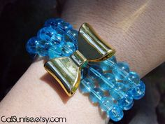 Take a look at our Stunung Glass Collection! Blue Glass Stacked with a Bow Bracelet  Beautiful by CaliSunrise, $12.00