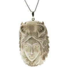 Nature Goddess Pendant Hand Carved Caribou Antler.  This finely carved piece resonates as a guardian spirit of the forest.