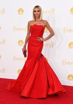 Loved the purple details on Giuliana Rancic dress at the 66th Annual Primetime Emmy Awards